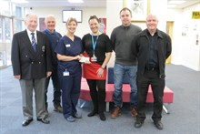 Golf club donation to maternity unit